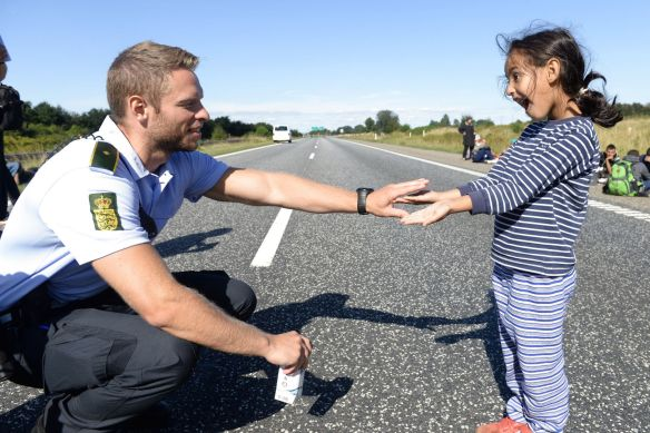 danish police man and refugee